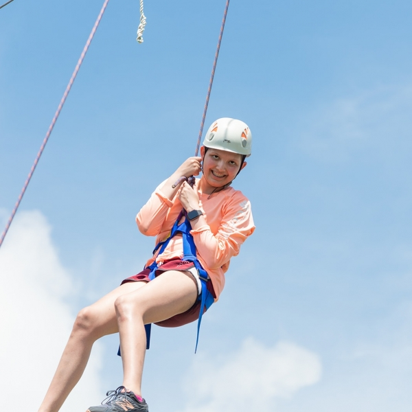 Camper from Camp TLC enjoying a ride on our zipline.